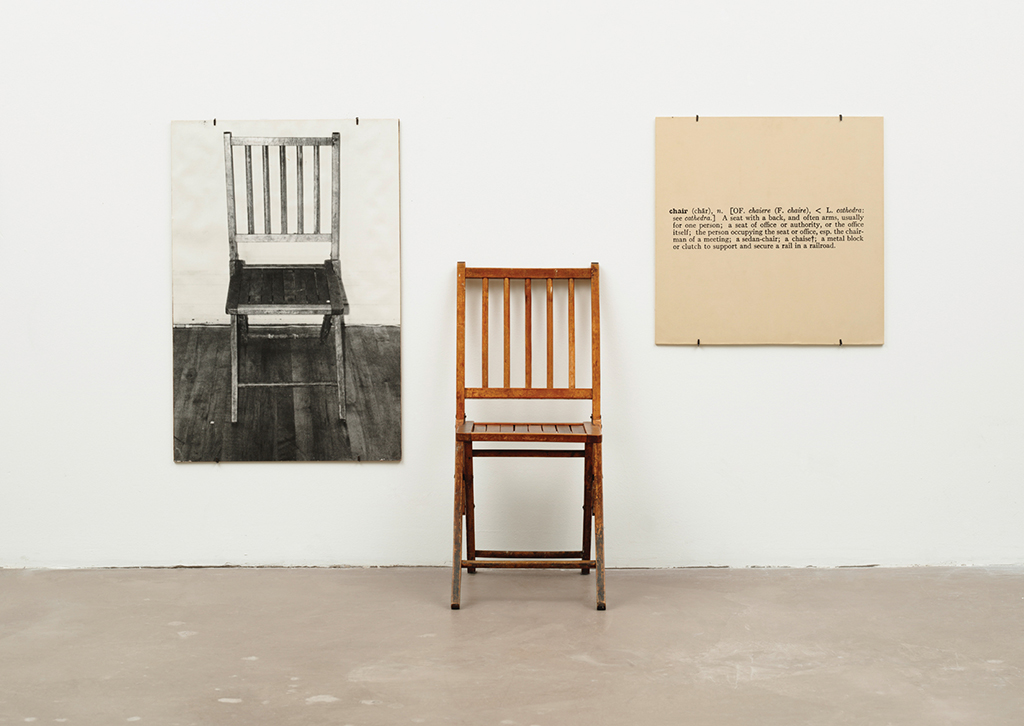 "One and Three Chairs: Kosuth shows three different instances of what we could call ""chair."" One instance is an actual chair, one is a large photograph of a chair, and the third is an enlarged reproduction of a typographic definition of ""chair"" from a dictionary. In each case, the viewer interprets the object as a chair. But, the artist challenges us to think about which one is the actual chair. We can say the physical object in front of us is an actual chair (unless we stand on it and use it as a ladder, then it becomes a ladder, no?). The photograph, however, is both an icon and an index of an actual chair. In reality, the photographic artifact is just a big piece of paper on which an image of a chair has been printed. And, in the case of the typographic dictionary definition, the chair is only in our mind as an implied representation of what we define as ""chair."" Again, this points to an indexical representation of our concept of ""chair."" It is implied. In this way, Kosuth prompts us to realize the semiotic constructs that operate in our visual language."
